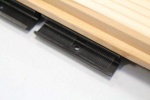 Système de clips pour les lames de bardage en cèdre massif